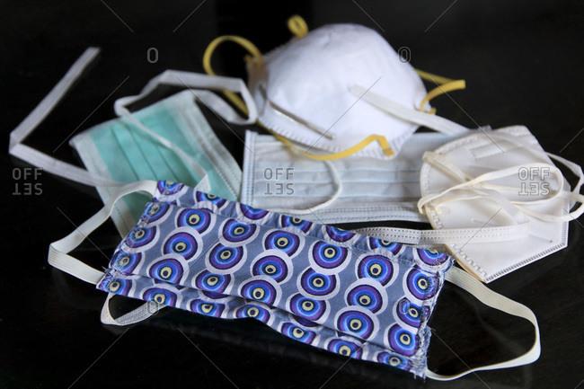 Still life on the theme of protective masks against coronavirus. Alternative fabric mask