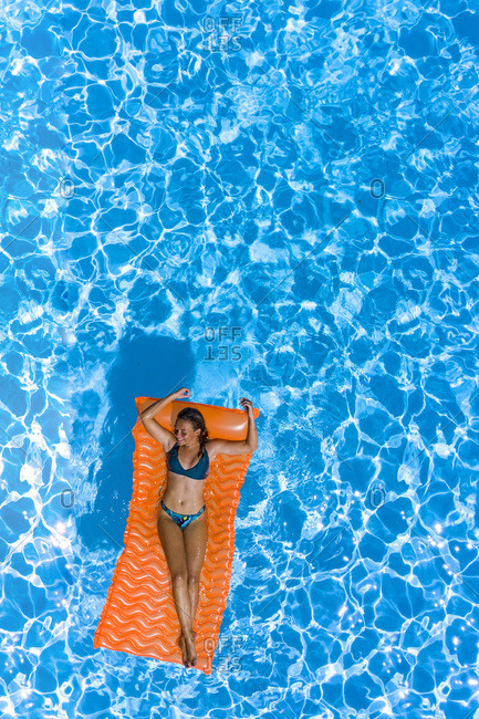 Woman on an air mattress in a swimming pool