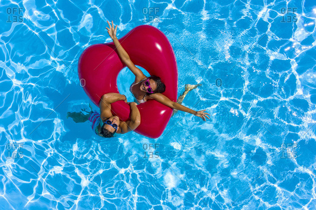 Young adult couple in a swimming pool