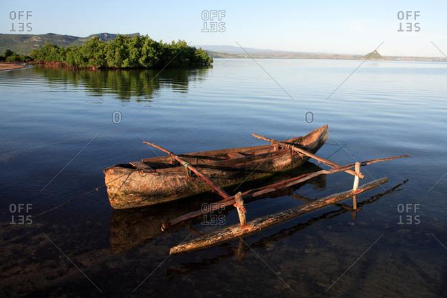 Madagascar,  near Diego Suarez,  boat in a mangrove swamp