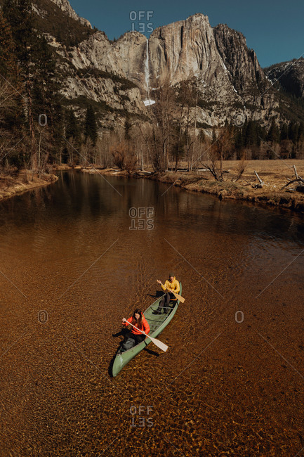 Young canoeing couple canoeing on river, high angle view, Yosemite Village, California, USA