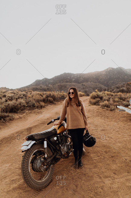 Woman beside motorbike, Kennedy Meadows, California, US