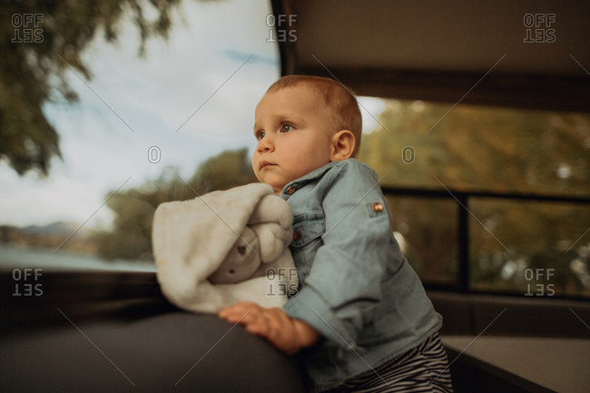 Baby looking out window of motorhome, Wanaka, Taranaki, New Zealand