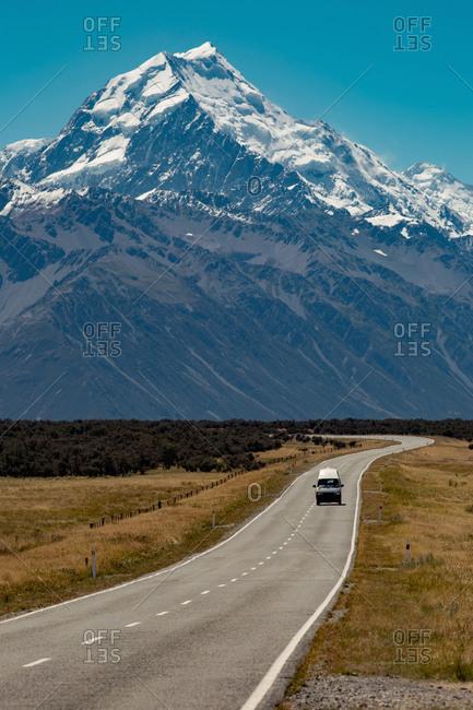 Scenic view of rural road leading towards mountains, Wanaka, Taranaki, New Zealand