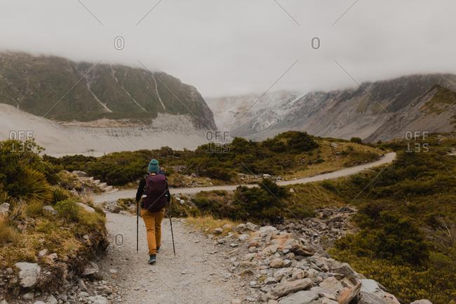 Hiker exploring trail, Wanaka, Taranaki, New Zealand
