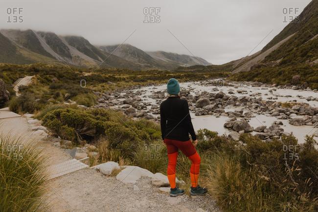 Hiker enjoying view of wilderness, Wanaka, Taranaki, New Zealand