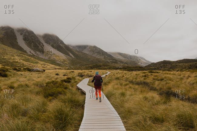 Hiker walking on trail path, Wanaka, Taranaki, New Zealand
