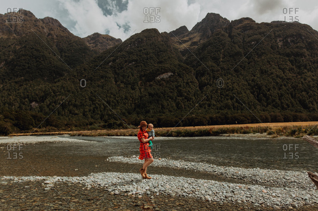 Mother and baby exploring lake, Queenstown, Canterbury, New Zealand