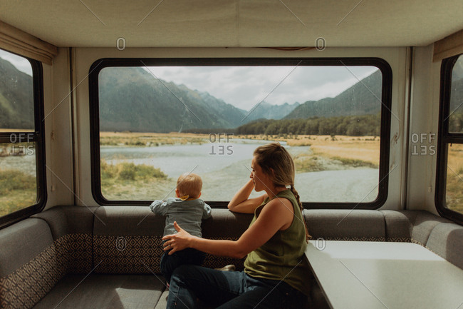 Mother and baby relaxing in motorhome, Queenstown, Canterbury, New Zealand