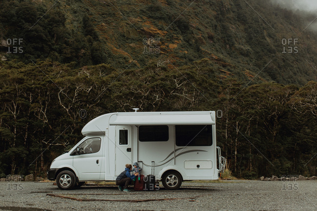 Mother with baby beside motorhome, Queenstown, Canterbury, New Zealand