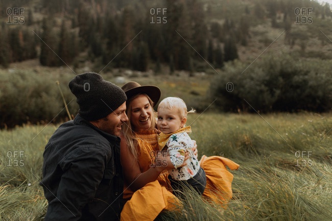 Female toddler with mid adult parents in rural valley, portrait, Mineral King, California, USA