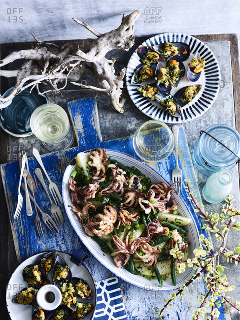 Baked baby octopus and mussels served with white wine