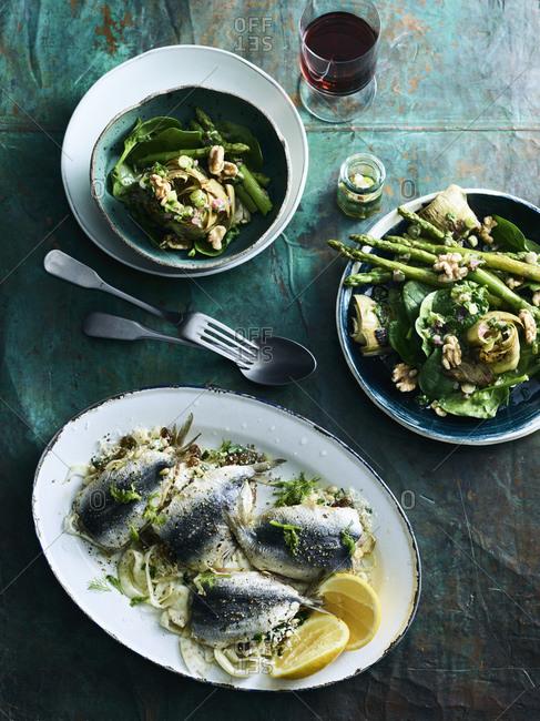 Warm asparagus and artichoke salad, and stuffed sardines