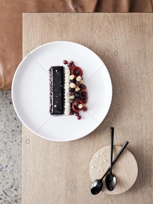 Glazed chocolate slice with soured cream cherries