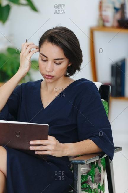 Businesswoman preparing paperwork in office