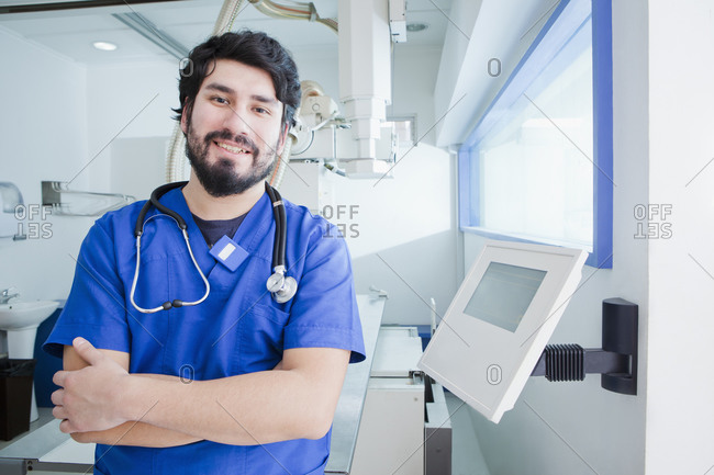 Young male radiographer in radiology department, portrait