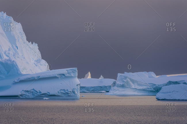 Icebergs under stormy sky, Lemaire channel, Antarctica