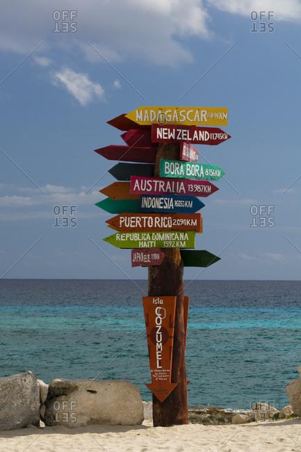 February 12, 2015: World distances sign post, Punta Sur Eco Park, Cozumel island, Mexico