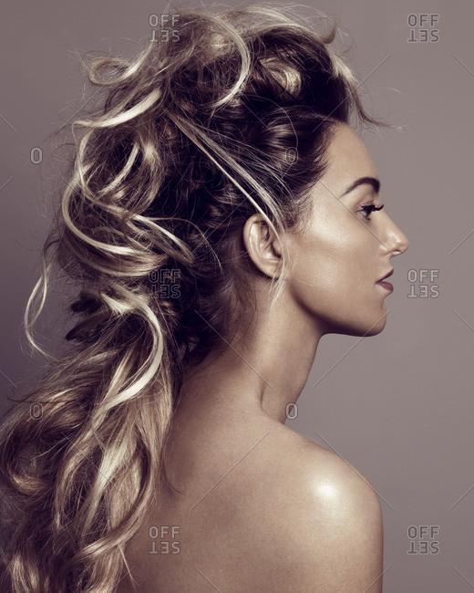 Beautiful young woman baring shoulders