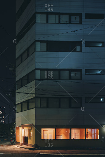 June 1, 2019: Night scene of an apartment building with the ground floor lit up, Osaka, Japan