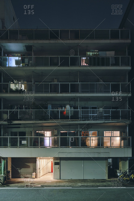June 1, 2019: Night scene of old apartment block building, Osaka, Japan