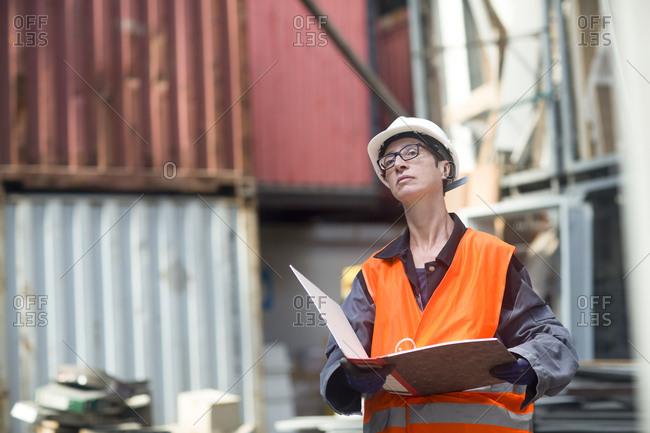 Woman working hard in warehouse
