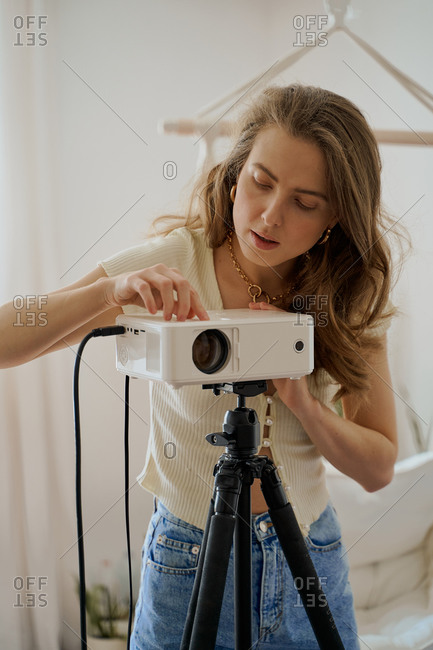 Woman setting up a video projector