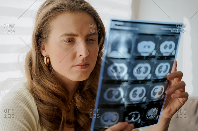 Woman looking at medical scans