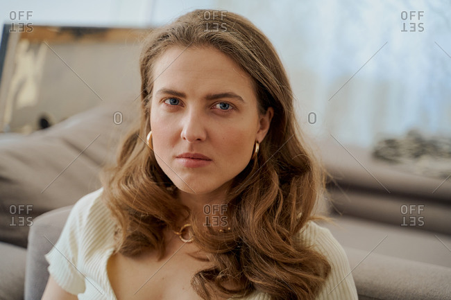 Portrait of a blonde woman staring seriously at the camera