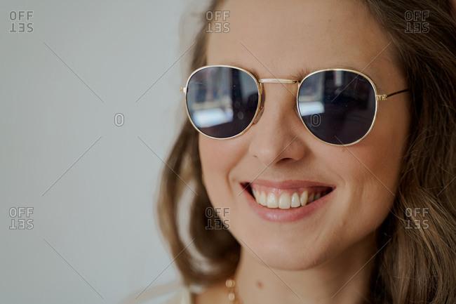 Blonde woman wearing sunglasses smiling