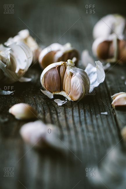 Fresh garlic cloves on rustic wooden surface