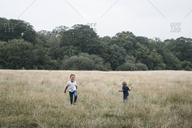 Two brothers playing in empty field