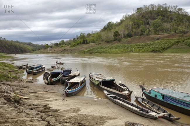 Boats on the banks of the Sangu river near the Bandarban District of Bangladesh
