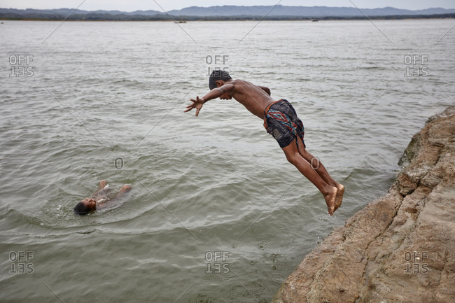 Rangamati, Bangladesh - May 5, 2013: Boys diving into the lake