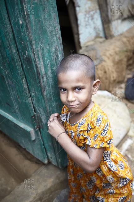 Rangamati, Bangladesh - May 5, 2013: Portrait of a young girl living in the slums of Bangladesh