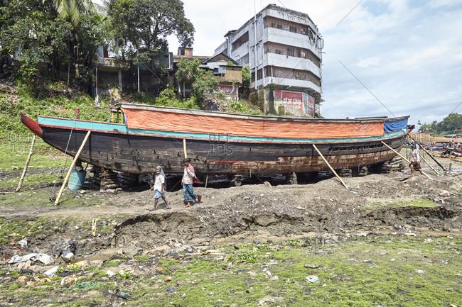 Large ship being repaired on land near Kaptai Lake, Rangamati, Bangladesh