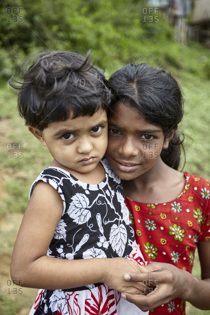 Rangamati, Bangladesh - May 5, 2013: Portrait of two young girls living in the slums of Bangladesh