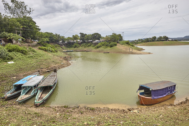 Rangamati, Bangladesh - May 5, 2013: Boats moored on the shore of Kaptai Lake