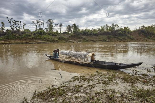 Bandarban, Bangladesh - May 6, 2013: Marma tribal man on a boat on the Sangu River