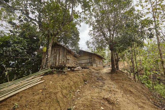 Bandarban, Bangladesh - May 6, 2013: Straw houses on hill in rural Bangladesh