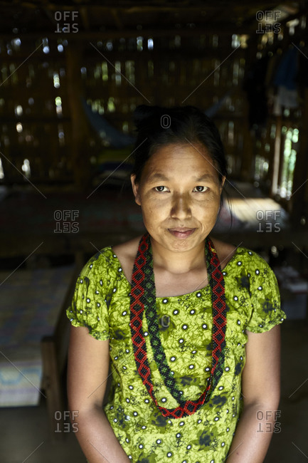 Bandarban, Bangladesh - May 6, 2013: Portrait of a Tripuri woman wearing green dress and beaded necklaces