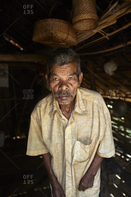 Bandarban, Bangladesh - May 6, 2013: Portrait of a Tripuri man inside a straw hut