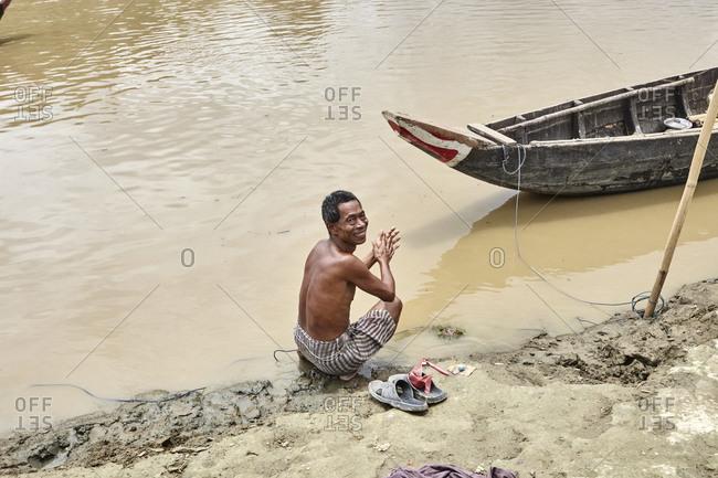 Bandarban, Bangladesh - May 6, 2013: Man on banks of the River Sangu
