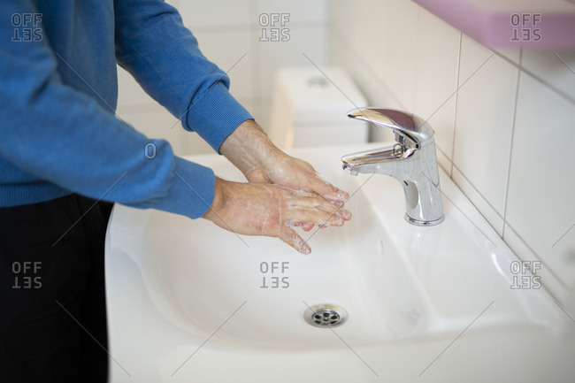 Man wash his hands with soap