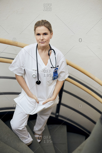Female doctor standing on stairs
