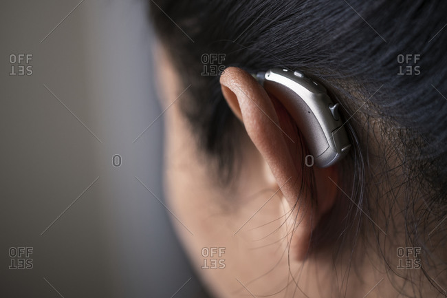Close-up of woman with hearing aid
