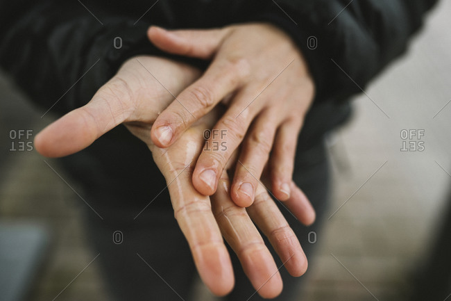 Cleaning hands with hand sanitizer
