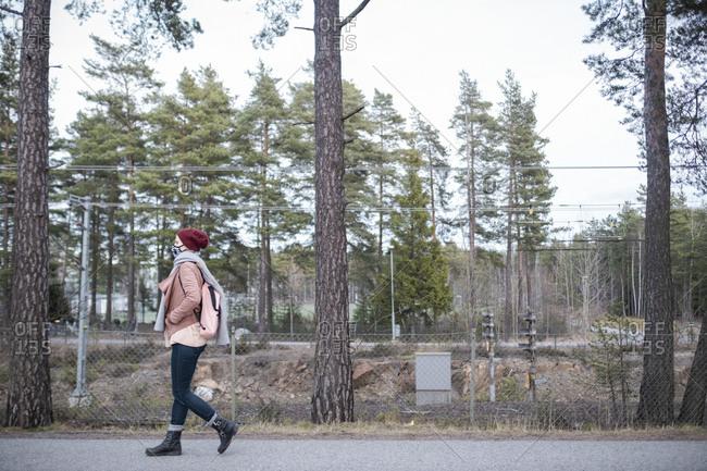 Woman walking outside along railroad