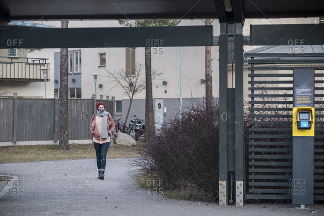 Woman walking to bus stop