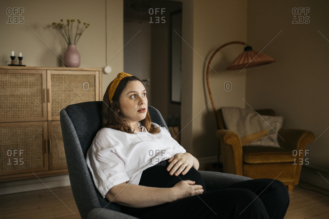 Pregnant woman resting in chair